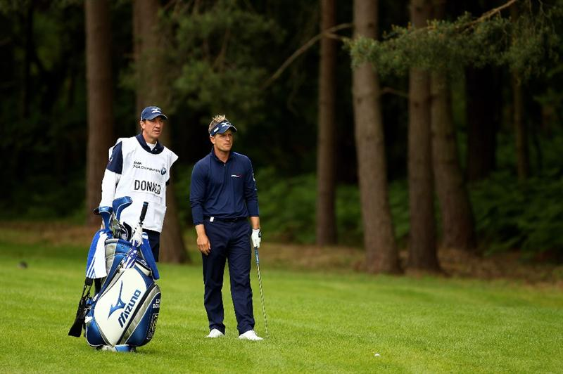 VIRGINIA WATER, ENGLAND - MAY 27:   Luke Donald of England waits with his caddie John McLaren during the second round of the BMW PGA Championship at the Wentworth Club on May 27, 2011 in Virginia Water, England.  (Photo by Richard Heathcote/Getty Images)