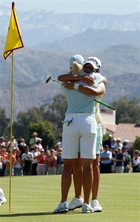 RANCHO MIRAGE, CA - APRIL 04:  Yani Tseng of Taiwan embraces Suzann Pettersen of Norway after holing the winning putt on the 18th green during the final round of the 2010 Kraft Nabisco Championship, on the Dinah Shore Course at The Mission Hills Country Club, on April 4, 2010 in Rancho Mirage, California.  (Photo by David Cannon/Getty Images)