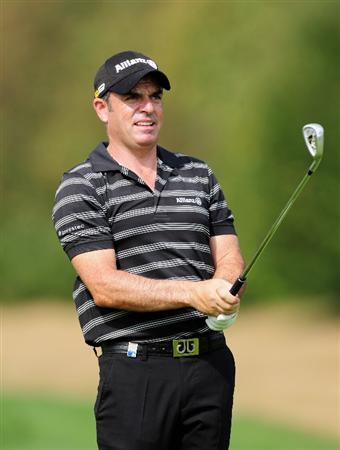 COLOGNE, GERMANY - SEPTEMBER 09:  Paul McGinley of Ireland plays his approach shot during the pro - am Mercedes-Benz Championship at The Gut Larchenhof Golf Club on September 9, 2009 in Pulheim, near Cologne, Germany.  (Photo by Stuart Franklin/Getty Images)