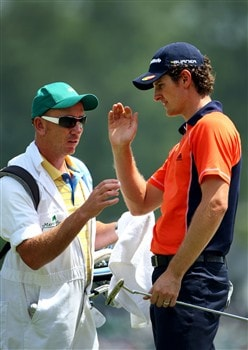 AUGUSTA, GA - APRIL 11:  Justin Rose of England chats with his caddie Michael Doran on the first hole during the second round of the 2008 Masters Tournament at Augusta National Golf Club on April 11, 2008 in Augusta, Georgia.  (Photo by Andrew Redington/Getty Images)