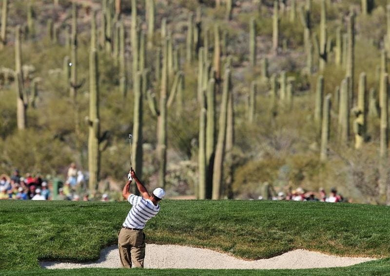 MARANA, AZ - FEBRUARY 26:  Tiger Woods of USA plays his bunker shot on the 14th hole during the second round of Accenture Match Play Championships at Ritz - Carlton Golf Club at Dove Mountain on February 26, 2009 in Marana, Arizona.  (Photo by Stuart Franklin/Getty Images)