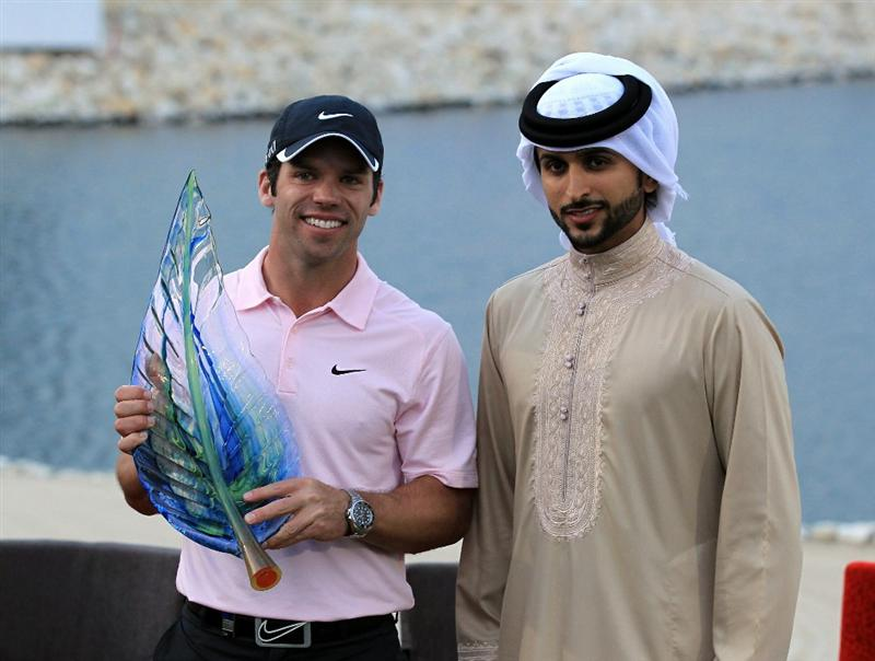BAHRAIN, BAHRAIN - JANUARY 30:  Paul Casey of England holds the trophy by His Highness Shaikh Nasser Bin Hamed Al Khalifa The Chairman of the Supreme Council for Youth and Sport and President of the Bahrain Olympic Committee after the final round of the 2011 Volvo Champions held at the Royal Golf Club on January 30, 2011 in Bahrain, Bahrain.  (Photo by David Cannon/Getty Images)