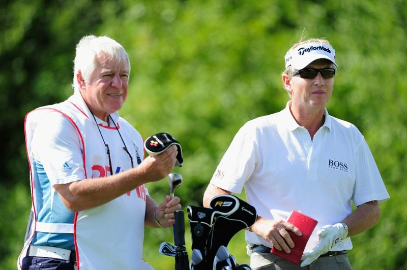 VIENNA, AUSTRIA - SEPTEMBER 18:  Philip Golding of England and caddie Paul Cast discuss his tee shot on the 15th hole during the third round of the Austrian golf open presented by Botarin at the Diamond country club on September 18, 2010 in Atzenbrugg near Vienna, Austria.  (Photo by Stuart Franklin/Getty Images)