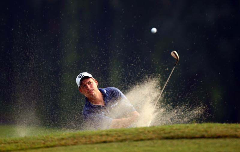 KUALA LUMPUR, MALAYSIA - FEBRUARY 12:  David Howell of England chips out of a bunker on the 15th hole during the first round of the 2009 Maybank Malaysian Open at Saujana Golf and Country Club on February 12, 2009 in Kuala Lumpur, Malaysia.  (Photo by Ian Walton/Getty Images)
