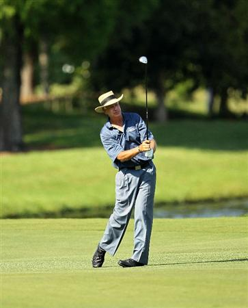 LUTZ, FL - APRIL 15:  Bruce Fleisher hits his approach shot on the 15th hole during the first round of the Outback Steakhouse Pro-Am at the TPC of Tampa on April 15, 2011 in Lutz, Florida.  (Photo by Mike Ehrmann/Getty Images)