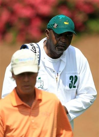 AUGUSTA, GA - APRIL 08:  Caddie Carl Jackson (R) walks with his player Ben Crenshaw on the tenth hole during the second round of the 2011 Masters Tournament at Augusta National Golf Club on April 8, 2011 in Augusta, Georgia.  (Photo by David Cannon/Getty Images)