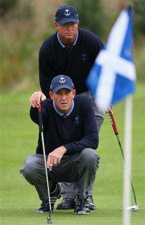 DUMBARTON, SCOTLAND - SEPTEMBER 18:  Sonny Skinner and Kyle Flinton of the USA line up a shot on the 6th green in the afternoon four ball matches at The Carrick on Loch Lomond on September 18, 2009 in Dumbarton, Scotland.  (Photo by Jeff J Mitchell/Getty Images)