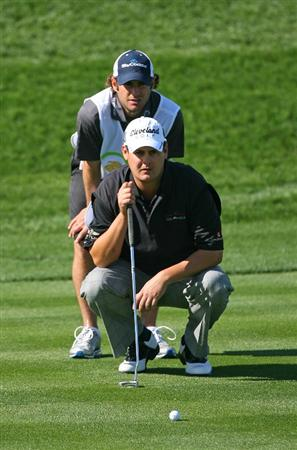 SCOTTSDALE, AZ - FEBRUARY 26: Jeff Quinney lines up his third shot on the eighth hole during the second round of the Waste Management Phoenix Open at TPC Scottsdale on February 26, 2010 in Scottsdale, Arizona. (Photo by Hunter Martin/Getty Images)
