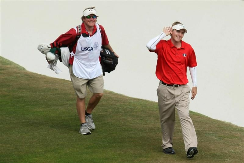 PEBBLE BEACH, CA - JUNE 20:  Amateur Russell Henley walks to the 18th green with his caddie Jeffrey Aronson during the final round of the 110th U.S. Open at Pebble Beach Golf Links on June 20, 2010 in Pebble Beach, California.  (Photo by Stephen Dunn/Getty Images)