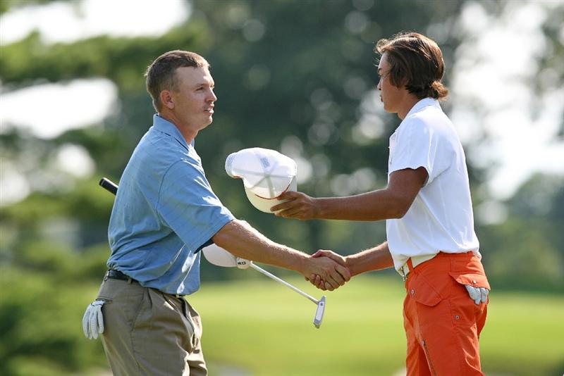 COLUMBUS, OH - AUGUST 02 : Derek Lamely (L) shakes hands with Rickie Fowler after winning the tournament on the second playoff hole during the final round of the Nationwide Children's Hospital Invitational at The Ohio State Golf Club on August 2, 2009 in Columbus, Ohio. (Photo by Hunter Martin/Getty Images)