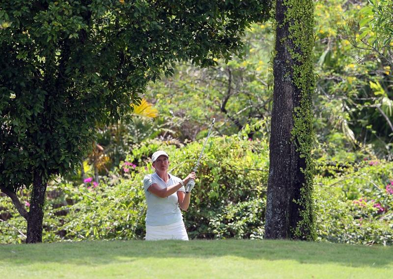 SINGAPORE - FEBRUARY 28:  Cristie Kerr of the USA hits her second shot on the 17th hole during the final round of the HSBC Women's Champions at Tanah Merah Country Club on February 28, 2010 in Singapore, Singapore.  (Photo by Andy Lyons/Getty Images)