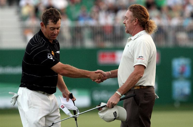 DUBAI, UNITED ARAB EMIRATES - FEBRUARY 07:  Miguel Angel Jimenez of Spain (right) shakes hands with Lee Westwood of England on the third play-off hole after winning the Omega Dubai Desert Classic on February 7, 2010 in Dubai, United Arab Emirates.  (Photo by Andrew Redington/Getty Images)
