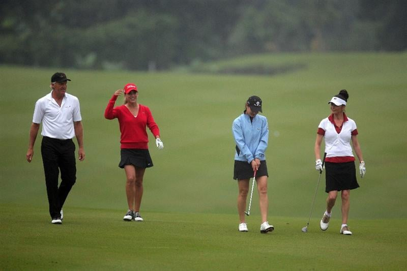 HAIKOU, CHINA - OCTOBER 27: (L-R) Golf legend Greg Norman, Belen Mozo of Spain, Former golf world number one Lorena Ochoa of Mexico and oscar-winning actress Catherine Zeta-Jones, walk ahead of the inaugural Mission Hills Star Trophy on October 27, 2010 in Haikou, China. The Mission Hills Star Trophy is Asia's leading leisure liflestyle event and features Hollywood celebrities and international golf stars.  (Photo by Athit Perawongmetha/Getty Images)