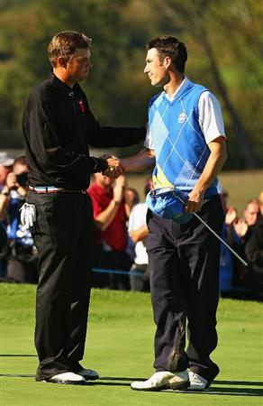 NEWPORT, WALES - OCTOBER 04:  Jeff Overton of the USA is congratulated by Ross Fisher (R) of Europe after winning his match on the 16th green in the singles matches during the 2010 Ryder Cup at the Celtic Manor Resort on October 4, 2010 in Newport, Wales.  (Photo by Richard Heathcote/Getty Images)