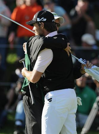 PACIFIC PALISADES, CA - FEBRUARY 20:  Aaron Baddeley of Australia celebrates winning with his caddie on the 18th hole during the final round of the Northern Trust Open at Riviera Country Club on February 20, 2011 in Pacific Palisades, California.  (Photo by Stuart Franklin/Getty Images)