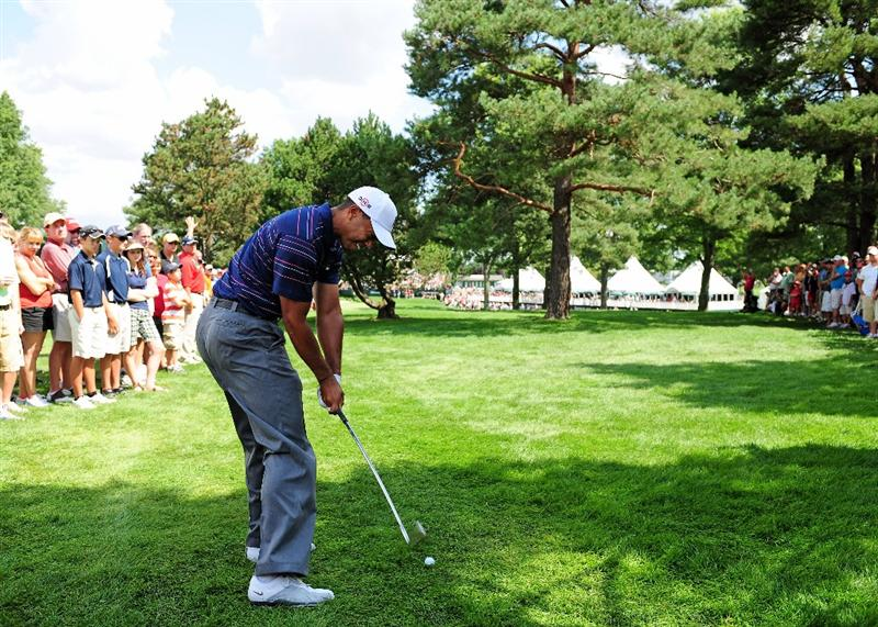 AKRON, OH - AUGUST 07:  Tiger Woods of USA plays his approach shot on the 18th hole during the second round of the World Golf Championship Bridgestone Invitational on August 7, 2009 at Firestone Country Club in Akron, Ohio.  (Photo by Stuart Franklin/Getty Images)