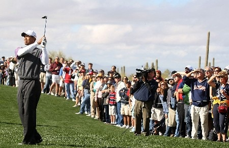 MARANA, AZ - FEBRUARY 23:  Tiger Woods watches his approach shot on the 12th hole during the quarterfinal matches of the WGC-Accenture Match Play Championship at The Gallery at Dove Mountain on February 23, 2008 in Marana, Arizona.  (Photo by Scott Halleran/Getty Images)