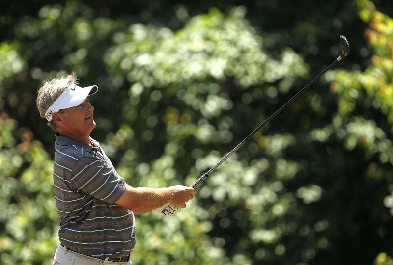 LUTZ, FL - APRIL 17:  John Cook hits his tee shot on the 13th hole during the final round of the Outback Steakhouse Pro-Am at the TPC of Tampa on April 17, 2011 in Lutz, Florida.  (Photo by Mike Ehrmann/Getty Images)