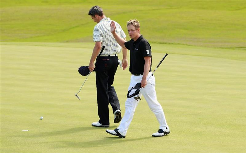 CASARES, SPAIN - MAY 20:  Luke Donald of England (right) celebrates after beating Ross Fisher of England (left) during the group stages of the Volvo World Match Play Championship at Finca Cortesin on May 20, 2011 in Casares, Spain.  (Photo by Andrew Redington/Getty Images)