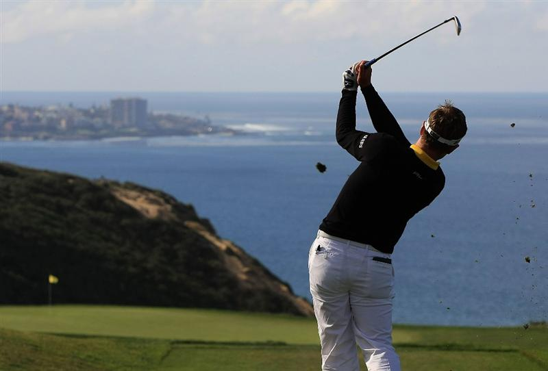 LA JOLLA, CA - FEBRUARY 05:  Luke Donald of England hits a shot on the third hole on the South Course during the first round of the Buick Invitational at the Torrey Pines Golf Course on February 5, 2009 in La Jolla, California.  (Photo by Scott Halleran/Getty Images)