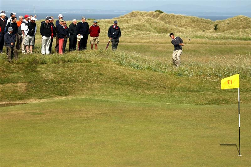 GULLANE, SCOTLAND - JUNE 18:  Rhys Enoch of Wales chips onto the 13th green during his Quarter Final match against Matthew Nixon of England for The Amateur Championship at Muirfield Golf Club on June 18, 2010 in Gullane, Scotland.  (Photo by Warren Little/Getty Images)
