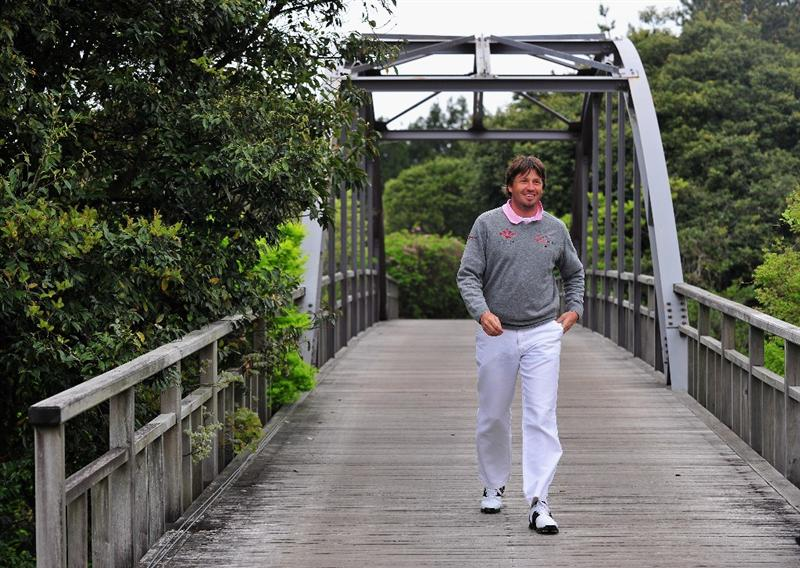 JEJU, SOUTH KOREA - APRIL 24:  Robert - Jan Derksen of The Netherlands walks across a bridge during the second round of the Ballantine's Championship at Pinx Golf Club on April 24, 2009 in Jeju, South Korea.  (Photo by Stuart Franklin/Getty Images)
