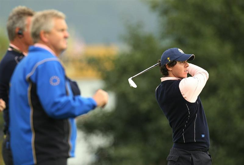 NEWPORT, WALES - SEPTEMBER 30:  Europe Team Captain Colin Montgomerie and Vice Captain Darren Clarke watch Rory McIlroy during a practice round prior to the 2010 Ryder Cup at the Celtic Manor Resort on September 30, 2010 in Newport, Wales.  (Photo by Ross Kinnaird/Getty Images)