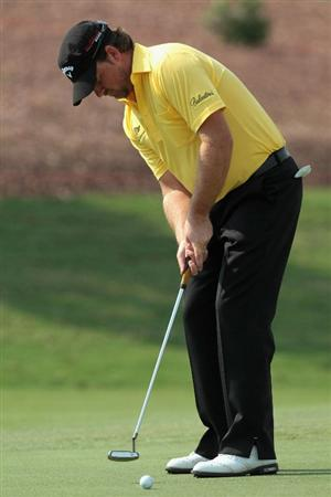 DUBAI, UNITED ARAB EMIRATES - NOVEMBER 23:  Graeme McDowell of Northern Ireland putts during the Pro Am prior to the start of the Dubai World Championship on the Earth Course, Jumeirah Golf Estates on November 23, 2010 in Dubai, United Arab Emirates.  (Photo by David Cannon/Getty Images)
