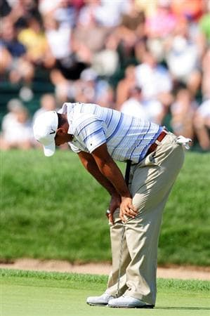 CHASKA, MN - AUGUST 14: Tiger Woods reacts to his putt on the ninth green during the second round of the 91st PGA Championship at Hazeltine National Golf Club on August 14, 2009 in Chaska, Minnesota.  (Photo by Stuart Franklin/Getty Images)