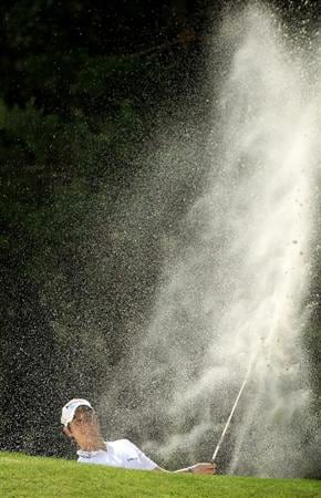 VIRGINIA WATER, ENGLAND - MAY 29:  Matteo Manassero of Italy hits from a bunker during the final round of the BMW PGA Championship  at the Wentworth Club on May 29, 2011 in Virginia Water, England.  (Photo by Warren Little/Getty Images)