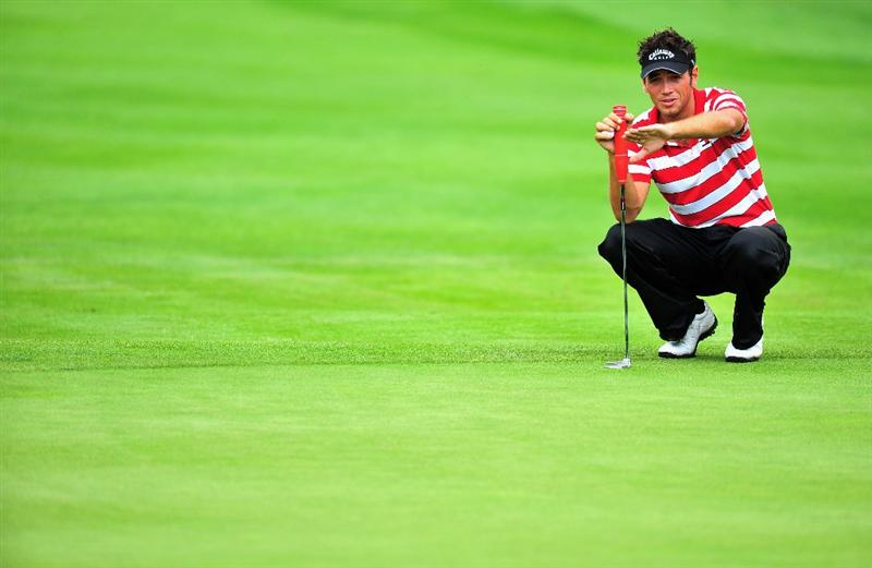 MUNICH, GERMANY - JUNE 27:  Nick Dougherty of England lines up his putt on the 10th hole during the third round of The BMW International Open Golf at The Munich North Eichenried Golf Club on June 27, 2009, in Munich, Germany.  (Photo by Stuart Franklin/Getty Images)