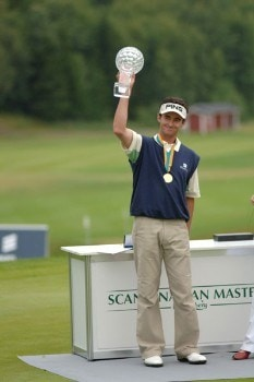 Mark Hensby celebrates with the trophy after the final round of of the 2005 Scandinavian Masters at Kungsangen Golf Club in Stockholm, Sweden on July 31, 2005.Photo by Torsten Laursen/WireImage.com