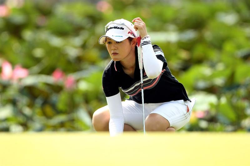 SINGAPORE - FEBRUARY 27:  Shinobu Moromizato of Japan lines up a putt on the seventh hole during the third round of the HSBC Women's Champions at the Tanah Merah Country Club on February 27, 2010 in Singapore.  (Photo by Andrew Redington/Getty Images)