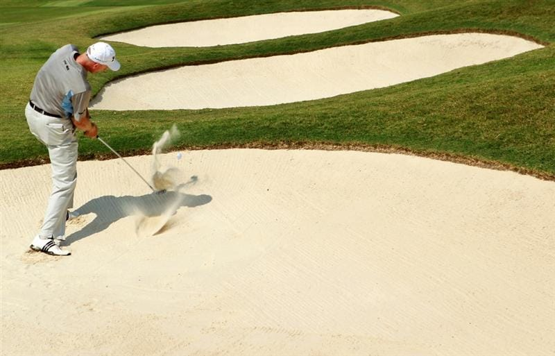 ATLANTA - SEPTEMBER 25:  Jim Furyk hits a shot from a bunker on the 17th hole during the third round of THE TOUR Championship presented by Coca-Cola at East Lake Golf Club on September 25, 2010 in Atlanta, Georgia.  (Photo by Scott Halleran/Getty Images)