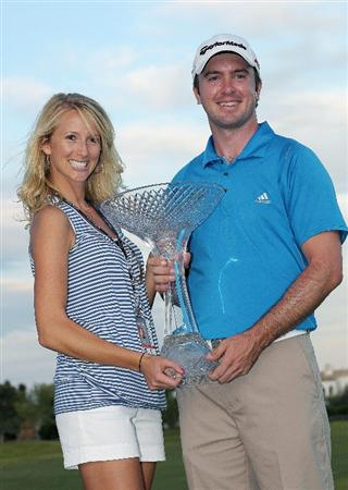 LAS VEGAS, NV- OCTOBER 18:  Martin Laird of Scoltand with his girlfriend Meagan holds the winner trophy at the Justin Timberlake Shriners Hospitals for Children Open at the TPC Summerlin on October 18, 2009  in Las Vegas, Nevada. (Photo by Marc Feldman/Getty Images)