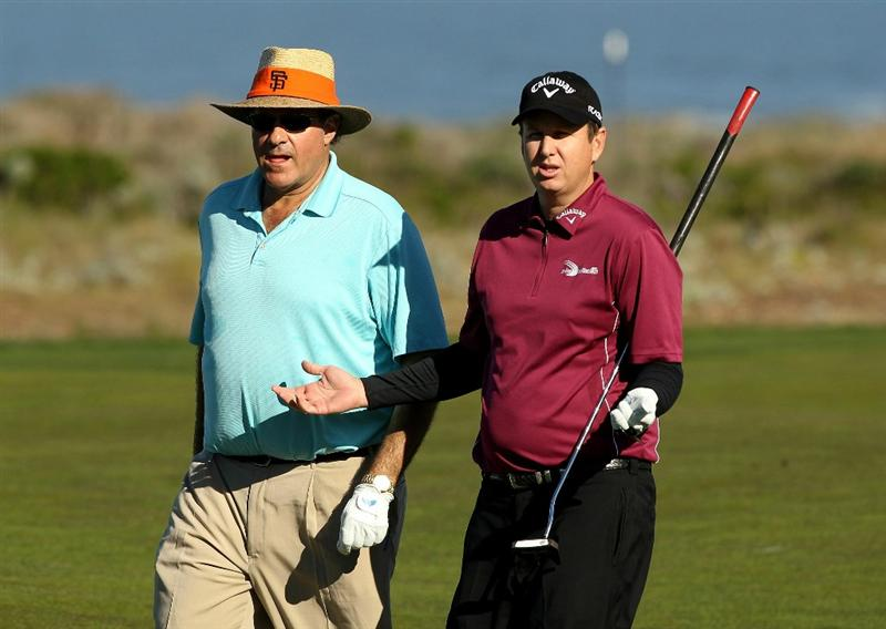 PEBBLE BEACH, CA - FEBRUARY 11:  J.J. Henry and Chris Berman walk down the fairway on the 13th hole during the second round of the AT&T Pebble Beach National Pro-Am at Monterey Peninsula Country Club on February 11, 2011 in Pebble Beach, California.  (Photo by Ezra Shaw/Getty Images)