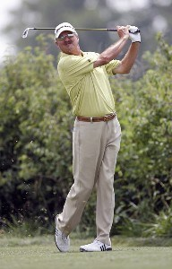 Gary McCord watches a tee shot during the third round of the U.S. Senior Open at Prairie Dunes Country Club in Hutchinson, Kansas on July 8, 2006.Photo by G. Newman Lowrance/WireImage.com