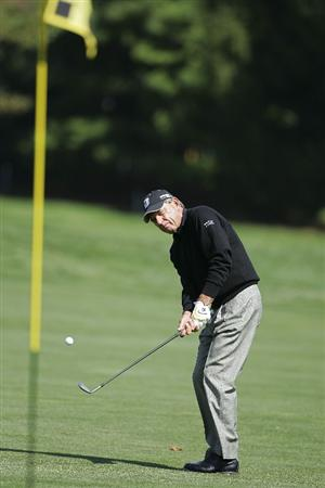 TIMONIUM, MD - OCTOBER 01:  Nick Price of Zimbabwe  plays an approach shot during the first round of the Constellation Energy Senior Players Championship at Baltimore Country Club/Five Farms (East Course) held on October 1, 2009 in Timonium, Maryland  (Photo by Michael Cohen/Getty Images)