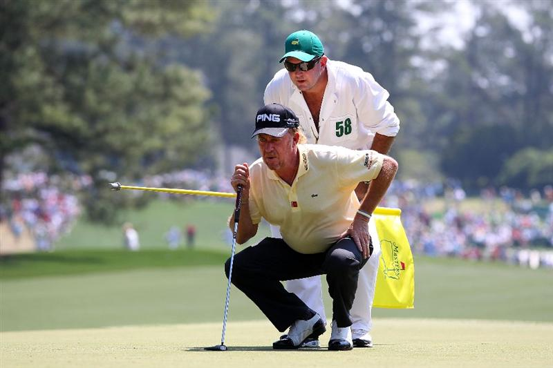 AUGUSTA, GA - APRIL 10:  Miguel Angel Jimenez of Spain lines up a putt on the first green with his caddie Mark Stannard during the final round of the 2011 Masters Tournament at Augusta National Golf Club on April 10, 2011 in Augusta, Georgia.  (Photo by Andrew Redington/Getty Images)