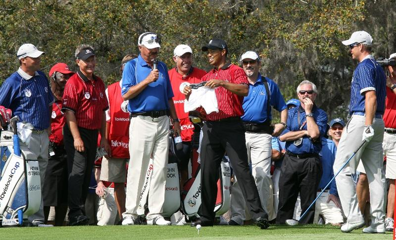 ORLANDO, FL - MARCH 16:  Tiger Woods of the USA and the Isleworth Team wathced by his partner John Cook present Henrik Stenson of Sweden (far right) and the Lake Nona Team with a brand new pair of underpants on the tee at the 1st hole during the first day of the 2009 Tavistock Cup at the Lake Nona Golf and Country Club, on March 16, 2009 in Orlando, Florida  (Photo by David Cannon/Getty Images)