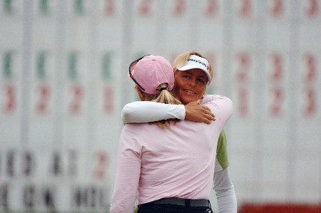 Liselotte Neumann hugs Charlotta Sorenstam on the 18th green   April 29 in  the rain-delayed second round of the 2005 Franklin American Mortgage Championship in Franklin, Tn.Photo by Al Messerschmidt/WireImage.com