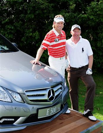 COLOGNE, GERMANY - SEPTEMBER 09:  Bernhard Langer of Germany and German tennis legend Boris Becker pose for a picture during the pro - am Mercedes-Benz Championship at The Gut Larchenhof Golf Club on September 9, 2009 in Pulheim, near Cologne, Germany.  (Photo by Stuart Franklin/Getty Images)