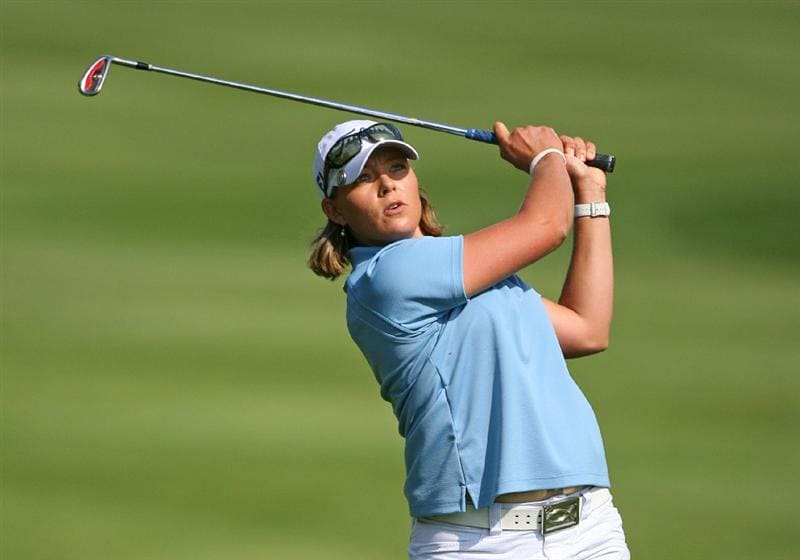 CALGARY, AB - SEPTEMBER 03: Katherine Hull of Australia hits her third shot on the ninth hole during the first round of the Canadian Women's Open at Priddis Greens Golf & Country Club on September 3, 2009 in Calgary, Alberta, Canada. (Photo by Hunter Martin/Getty Images)