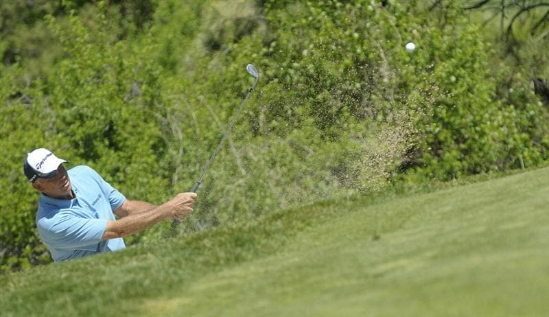PARKER, CO. - MAY 30: Tom Lehman hits a chip shot to the par three second  hole during the fourth and final round of the 71st Senior PGA Championship at the Colorado Golf Club on May 30, 2010 in Parker, Colorado.  (Photo by Marc Feldman/Getty Images)