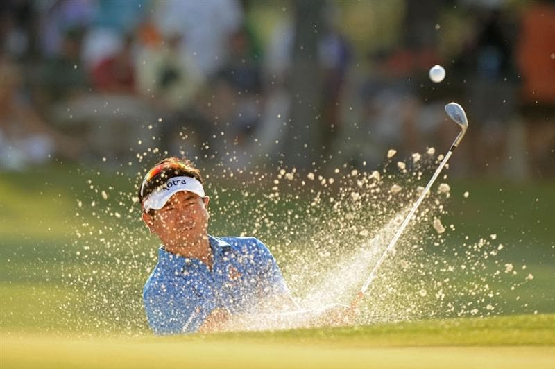 AUGUSTA, GA - APRIL 09:  Y.E. Yang of South Korea plays a bunker shot on the 17th hole during the third round of the 2011 Masters Tournament at Augusta National Golf Club on April 9, 2011 in Augusta, Georgia.  (Photo by Harry How/Getty Images)