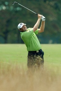 Steve Marino hits a shot from the rough along the 18th fairway  during the first round of the Wyndham Championship at Forest Oaks Country Club on August 16, 2007 in Greensboro, North Carolina. PGA TOUR - 2007 Wyndham Championship - First RoundPhoto by Jonathan Ernst/WireImage.com