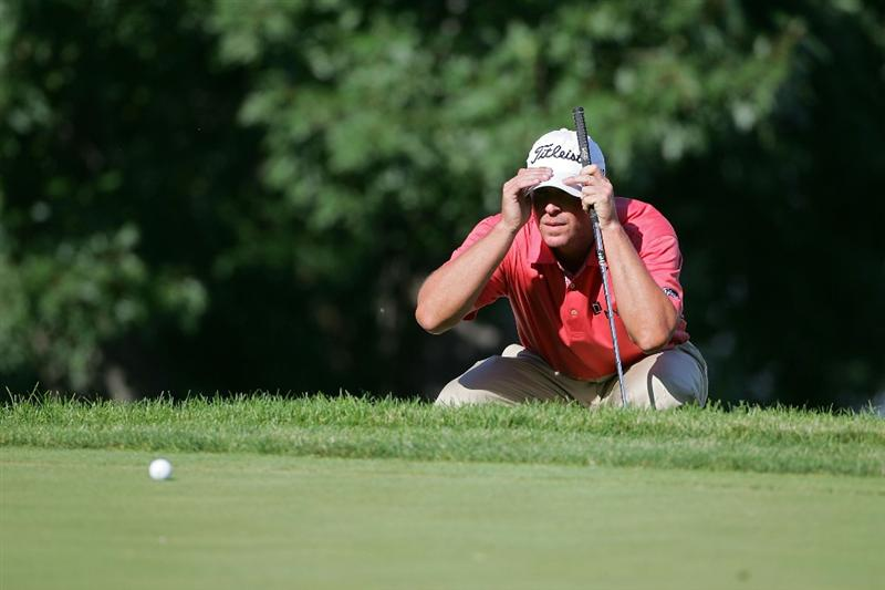 SILVIS, IL - JULY 12:  Steve Stricker of the USA lines up his putt on the 16th green during the final round of the John Deere Classic at TPC Deere Run held on July 12, 2009 in Silvis, Illinois.  (Photo by Michael Cohen/Getty Images)