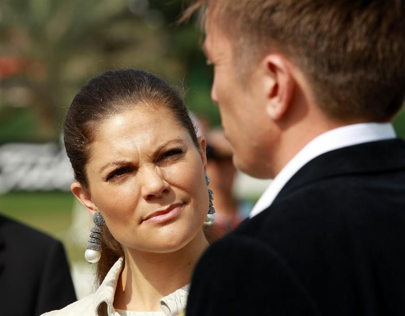 ABU DHABI, UNITED ARAB EMIRATES - JANUARY 20:  Princess Victoria of Sweden meets Johan Elliott of Sweden who manages Henrik Stenson of Sweden among other star professional golfers of Sweden before he teed off in the first round of the 2011 Abu Dhabi HSBC Golf Championship to be held at the Abu Dhabi Golf Club on January 20, 2011 in Abu Dhabi, United Arab Emirates.  (Photo by David Cannon/Getty Images)