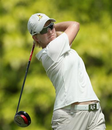 SINGAPORE - FEBRUARY 25:  Karrie Webb of the USA hits her tee-shot on the sixth hole during the second round of the HSBC Women's Champions at the Tanah Merah Country Club on February 25, 2011 in Singapore.  (Photo by Andrew Redington/Getty Images)