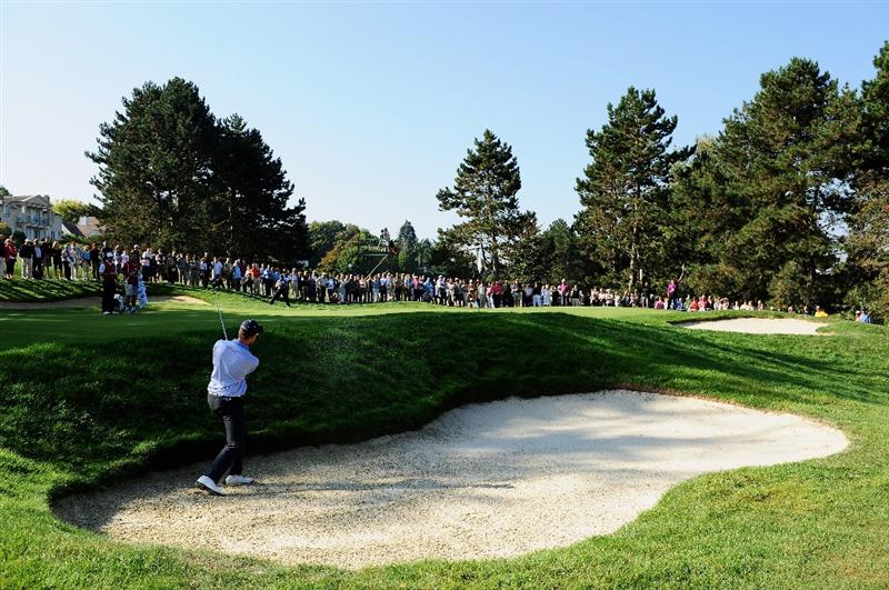 PARIS - SEPTEMBER 27:  Henrik Stenson of the Continental Europe plays his bunker shot on the second hole during the final day singles matches between Great Britain and Northern Ireland and Continental Europe at The Vivendi Trophy with Severiano Ballesteros at Saint - Nom - La Breteche golf course on September 27, 2009 in Paris, France.  (Photo by Stuart Franklin/Getty Images)